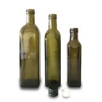 Antique green olive oil bottle with cap